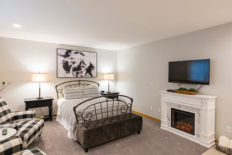 Bed with fireplace and TV